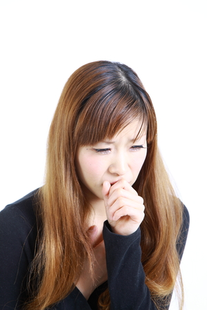 coughing: coughing woman Stock Photo