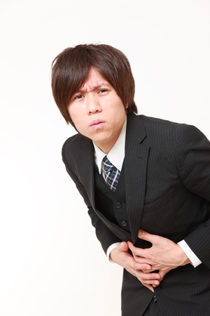 defecation: Japanese businessman suffers from stomachache Stock Photo