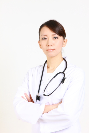 eager: young Japanese female doctor of eager expression