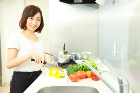 japanese foods: Japanese woman cooks in kitchen Stock Photo