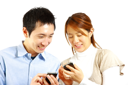 prime adult: Japanese couple with smart phone