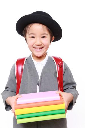 Japanese Schoolgirl carrying books photo
