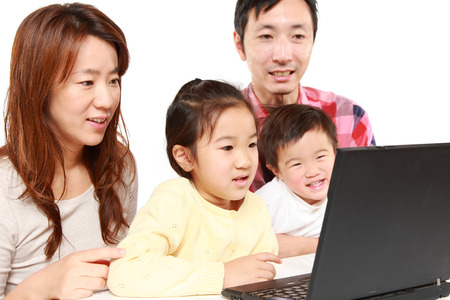 japanese family: Japanese family of four on laptop computer