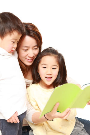 Japanese mother reading a book to her children photo