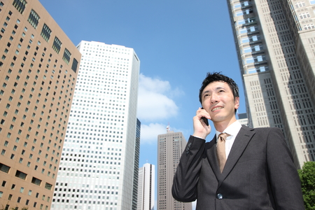 japanese businessman talks with a mobile phone  Фото со стока - 32615489