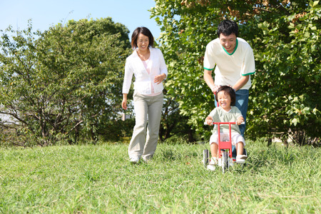 japanese family: Japanese family playing in the park Stock Photo