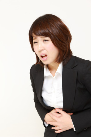 defecation: businesswoman suffers from stomachache Stock Photo