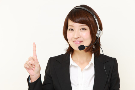 Japanese businesswoman presenting and showing something photo