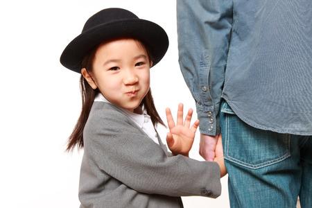 pre schooler: Japanese kindergartener walking to kindergarten with her father