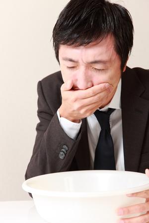 vomito: empresario v�mitos Foto de archivo