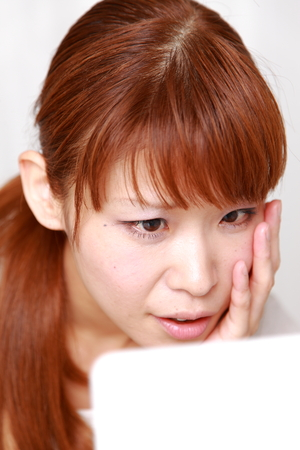 young Japanese woman worries about dry rough skin 写真素材