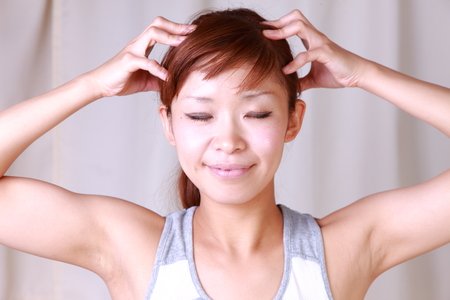 young woman doing self head massage