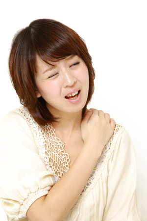 woman suffers from neck ache