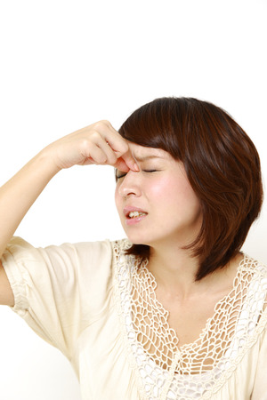 asian woman face: woman suffers from Asthenopia Stock Photo
