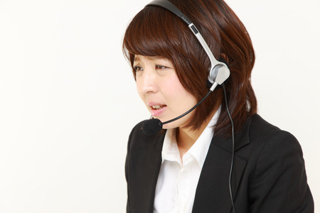businesswoman perplexed to a complaint telephone photo