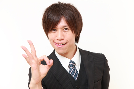 perfect sign: young Japanese Business man showing perfect sign Stock Photo
