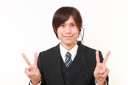 young Japanese Businessman showing a victory sign photo