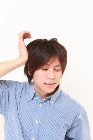 eyestrain: man suffers from headache