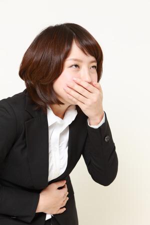 vomiting businesswoman photo