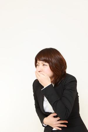 vomiting: vomiting businesswoman Stock Photo
