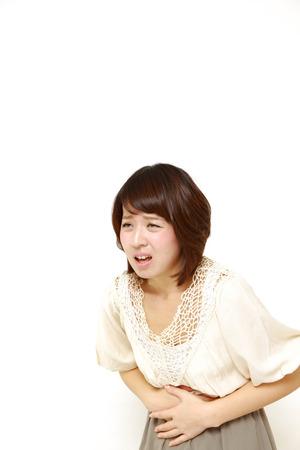 gastroenteritis: woman suffers from stomachache