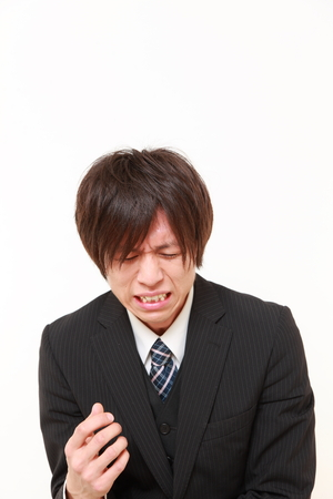 cries: young Japanese businessman cries