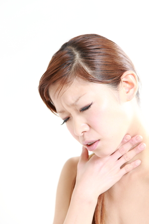 young Japanese woman suffers from throat pain