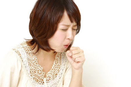 coughing woman Stock Photo