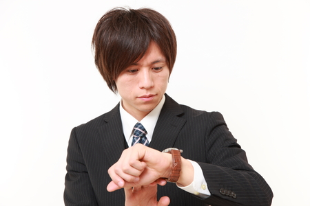 businessman checking time on his watch photo