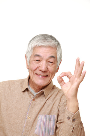 old sign: senior Japanese man showing perfect sign