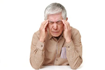 senior Japanese man suffers from headache