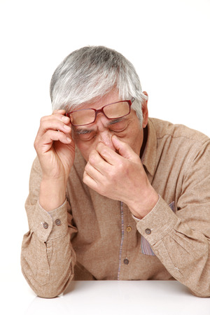 senior Japanese man suffers from Asthenopia