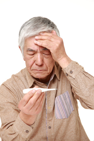 senior Japanese man with fever photo