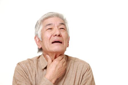 senior Japanese man having throat pain