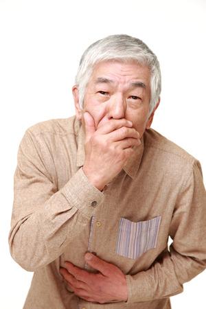 vomit: senior Japanese man vomit Stock Photo