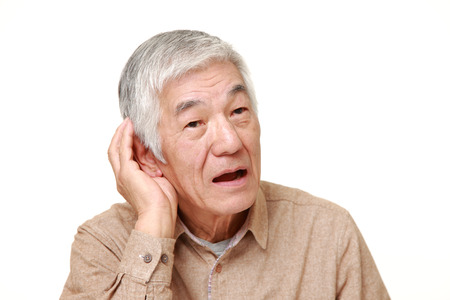 impaired: Hearing impaired senior Japanese man