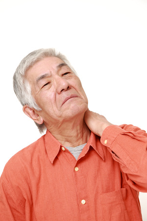senior man on a neck pain: senior Japanese man suffers from neck ache