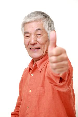 senior Japanese man with thumbs up gesture 免版税图像