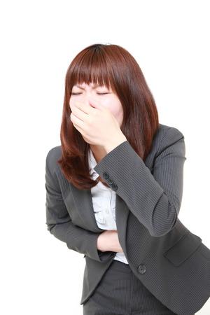 vomit: young Japanese businesswoman vomit