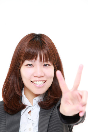 young Japanese Businesswoman showing a victory sign photo