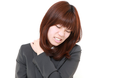 suffers: Japanese businesswoman suffers from neck ache