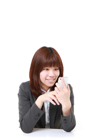 Young businesswoman with smart phone photo