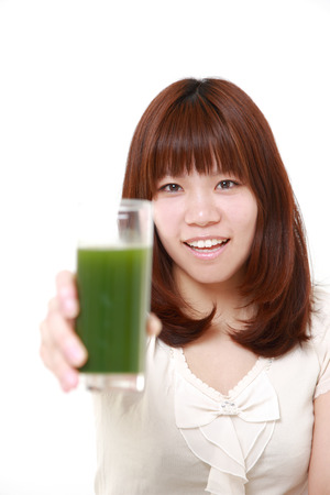 green vegetable: woman with green vegetable juice