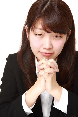 businesswoman folding her hands in prayer