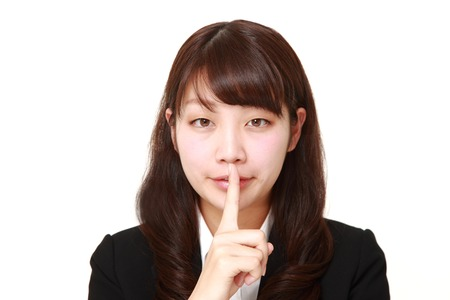 young Japanese businesswoman whith silence gestures Banco de Imagens