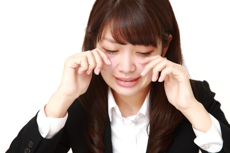 cries: portrait of a young Japanese businesswoman cries Stock Photo