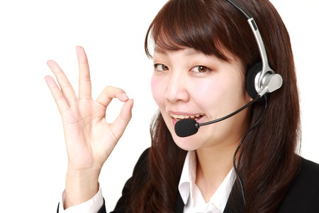 young Japanese Business woman of call center showing perfect sign photo