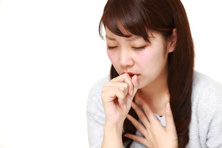 portrait of a young Japanese woman coughing