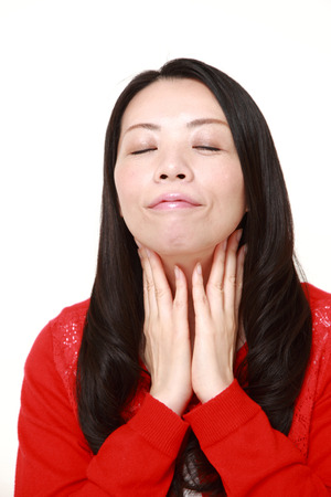 Japanese woman doing a self lymph node massage photo