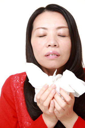 sneezing: woman with an allergy sneezing Stock Photo